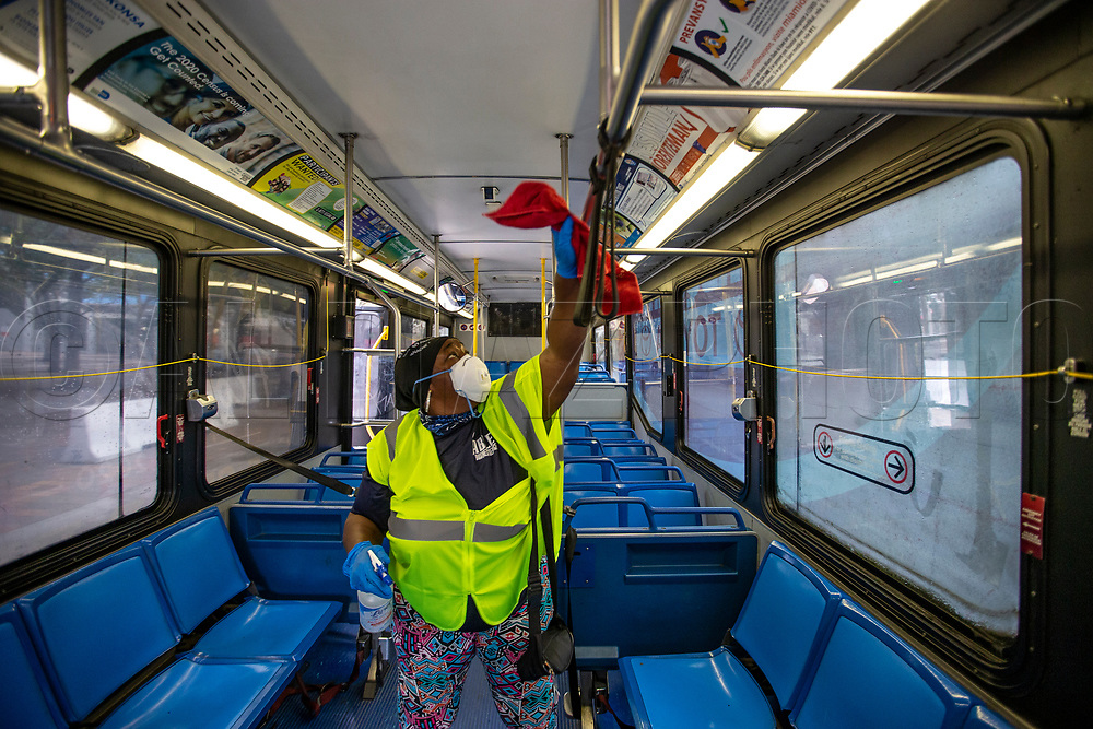 Miami Dade County Transit Employee Twyla Sawyer decontaminates a Metrobus in downtown Miami during COVID19 pandemic in Miami on Wednesday, April 1, 2020.