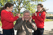 18/09/2014 repro free  Yasmin Kerr and Aisling Joyce from  Scoil Eanna Roundstone with renowned composer Bob Whelan at the opening of the 37th Clifden Arts Festival which runs till the 28th of Sept more info: www.clifdenartsweek.ie