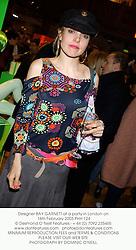 Designer BAY GARNETT at a party in London on 16th February 2003.PHH 124