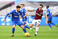 Football - 2020 / 2021 Premier League - West Ham United vs Brighton & Hove Albion - London Stadium<br /> <br /> Brighton & Hove Albion's Adam Lallana holds off the challenge from West Ham United's Mark Noble.<br /> <br /> COLORSPORT/ASHLEY WESTERN