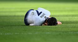 Tottenham Hotspur's Son Heung-min lies on the pitch