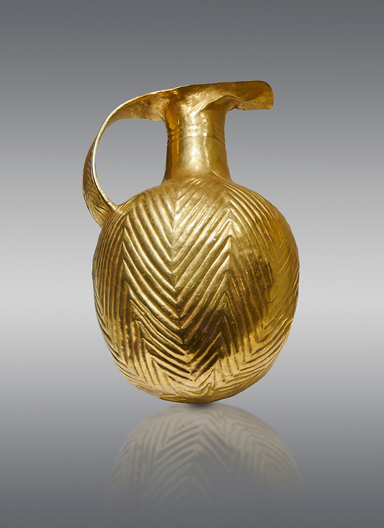 Bronze Age Hattian gold flask from a possible Bronze Age Royal grave (2500 BC to 2250 BC) - Alacahoyuk - Museum of Anatolian Civilisations, Ankara, Turkey. Against a gray background .<br /> <br /> If you prefer to buy from our ALAMY PHOTO LIBRARY  Collection visit : https://www.alamy.com/portfolio/paul-williams-funkystock/royal-tombs-alaca-hoyuk-bronze-age.html (TIP refine search by adding background colour in the LOWER search box)<br /> <br /> Visit our ANCIENT WORLD PHOTO COLLECTIONS for more photos to download or buy as wall art prints https://funkystock.photoshelter.com/gallery-collection/Ancient-World-Art-Antiquities-Historic-Sites-Pictures-Images-of/C00006u26yqSkDOM