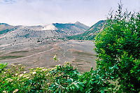 Java, East Java, Mount Bromo. Bromo is a smoking cone inside the huge, older crater Tengger. Gunung Batok to the right of Bromo.