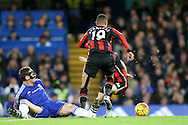Nemanja Matic of Chelsea tackles Junior Stanislas of Bournemouth.Barclays Premier league match, Chelsea v AFC Bournemouth at Stamford Bridge in London on Saturday 5th December 2015.<br /> pic by John Patrick Fletcher, Andrew Orchard sports photography.