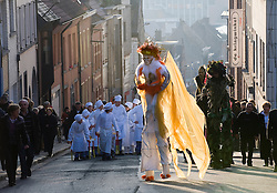 """Geraardsbergen, Belgium - Every year in the Flemish village of Geraardsbergen, residents gather for the spring festival """"Krakelingenfeesten"""", (Krakelingen festival) which combines a surreal combination of Pagan and Christian rituals. The towns people parade to the highest point in the village, where """"worthies"""", including a Catholic priest, drink live fish swimming in wine, from a grail served by elders dressed as Druids. The """"worthies"""" then throw biscuits to the crowd. The drinking of the live fish has become a controversial issue, with animal rights activists lobbying to have the traditional practice banned. (Photo © Jock Fistick)"""