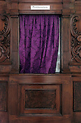close up of curtain of a confession booth