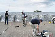 recreational fishing at Umikaze park, Yokosuka with Tokyo Bay and Sarushima Island