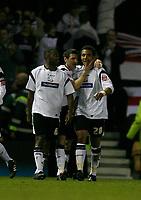 Derby celebrate again. Giles Barnes (right) scores No 3
