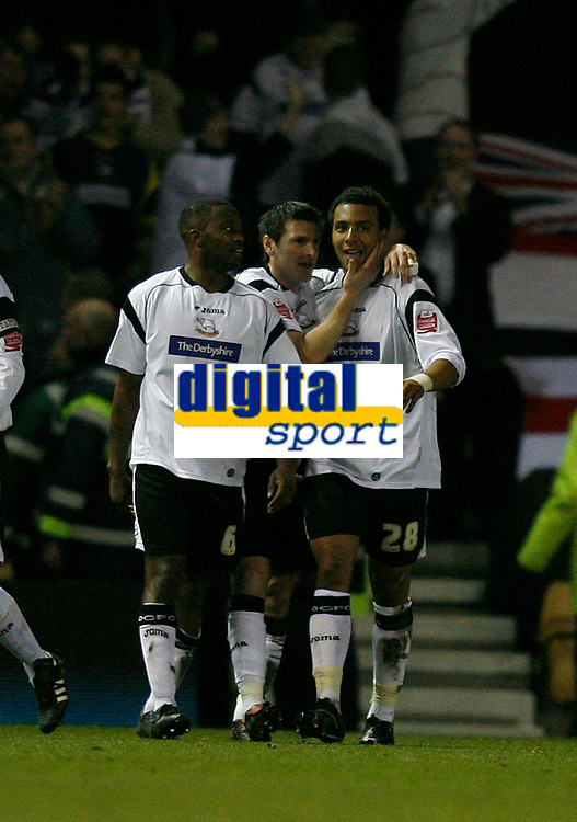 Derby celebrate again. Giles Barnes (right) scores No 3