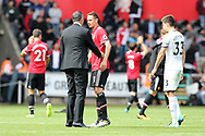 Paul Clement, the Swansea city manager (l) speaks with Nemanja Matic of Manchester Utd on the pitch at the end of the match.  Premier league match, Swansea city v Manchester Utd at the Liberty Stadium in Swansea, South Wales on Saturday 19th August 2017.<br /> pic by  Andrew Orchard, Andrew Orchard sports photography.