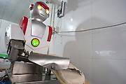 "HANGZHOU, CHINA -  (CHINA OUT) <br /> <br /> A Robot Cook <br /> A robot dressed as superman ""Ultraman"" slices noodles at a restaurant  in Hangzhou, Zhejiang Province of China. The restaurant owner bought this robot with 14,000 RMB (about 2,200 USD) to substitute employees. The robot was invented by Chinese Cui Runquan in 2006. <br /> ©ChinaFoto/Exclusivepix"