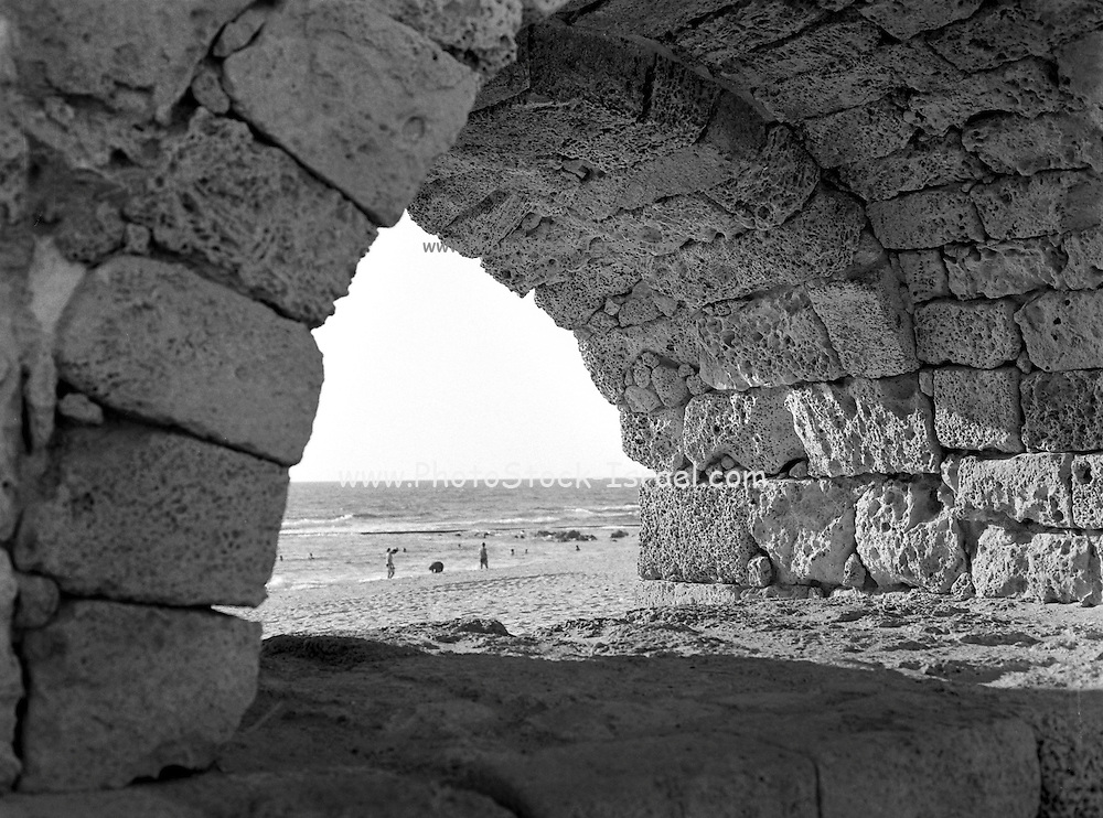 Israel, coastal plains, North of Caesarea, Remains of the Roman Aqueduct that carried fresh water from the Carmel Mountains to the city of Caesarea Maritima. Archival image