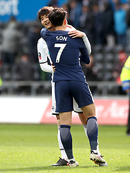 Tottenham Hotspur's Son Heung-Min and Swansea City's Ki Sung-yueng hug each other at the end of the Emirates FA Cup, quarter final match at the Liberty Stadium, Swansea.