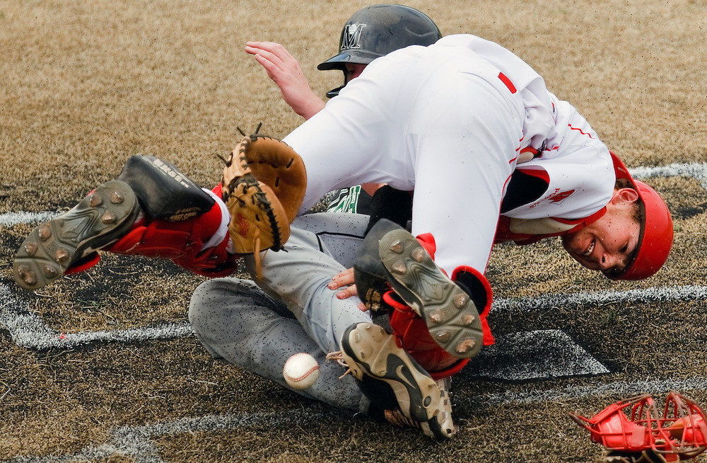 Grand Island catcher Phoenix Stevenson can't hold onto the ball as Millard West's Eric Salmonson slides into home in the third inning of Saturday's first round game at Memorial Park in Kearney. Millard West won 8-3. (Independent/Matt Dixon)