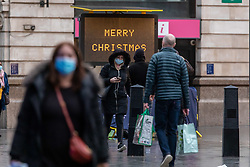 © Licensed to London News Pictures. 22/12/2020. London, UK. Commuters and travellers are greeted with a Merry Christmas sign as they arrive at an almost empty Victoria Station in London this morning as chaotic scenes of bulk buying and stacked up lorries on motorways unfold in supermarkets and the Port of Dover over the French travel ban to Europe. Yesterday a huge rush of shoppers descended on store causing long queues in the aisles and empty shelves after news that French customs blocked freight from leaving the Port of Dover after a spike in infections due to the Covid-19 mutation. Last week Prime Minister Boris Johnson put London and parts of the South East into Tier 4 lockdown after the new Covid-19 mutation was discovered. Photo credit: Alex Lentati/LNP