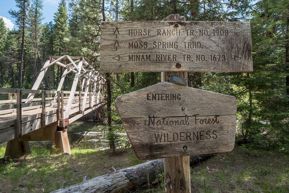 Trail junction sign and packbridge in Oregon's Wallowa Mountains.