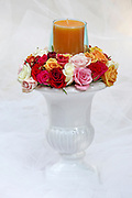 Roses Arrangement with candle on white