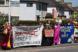 Environmental activists in period costume from groups opposed to the HS2 high-speed rail link restage a historical 1602 visit by Queen Elizabeth I to Dews Farm on 31st July 2020 in Harefield, United Kingdom. The activists tried to retrace the steps of Queen Elizabeth I from St Mary's church to Dews Farm in order to pay their respects to Anne and Ron Ryall, 73 and 72, on the day of their eviction from Dews Farm by HS2 after having spent nine years and their life savings renovating their £1m dream home, but found their path blocked by HS2 fences and security guards.