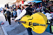 A Mexican mariachi band walks through the Tuesday Market in San Miguel de Allende, Guanajuato, Mexico.