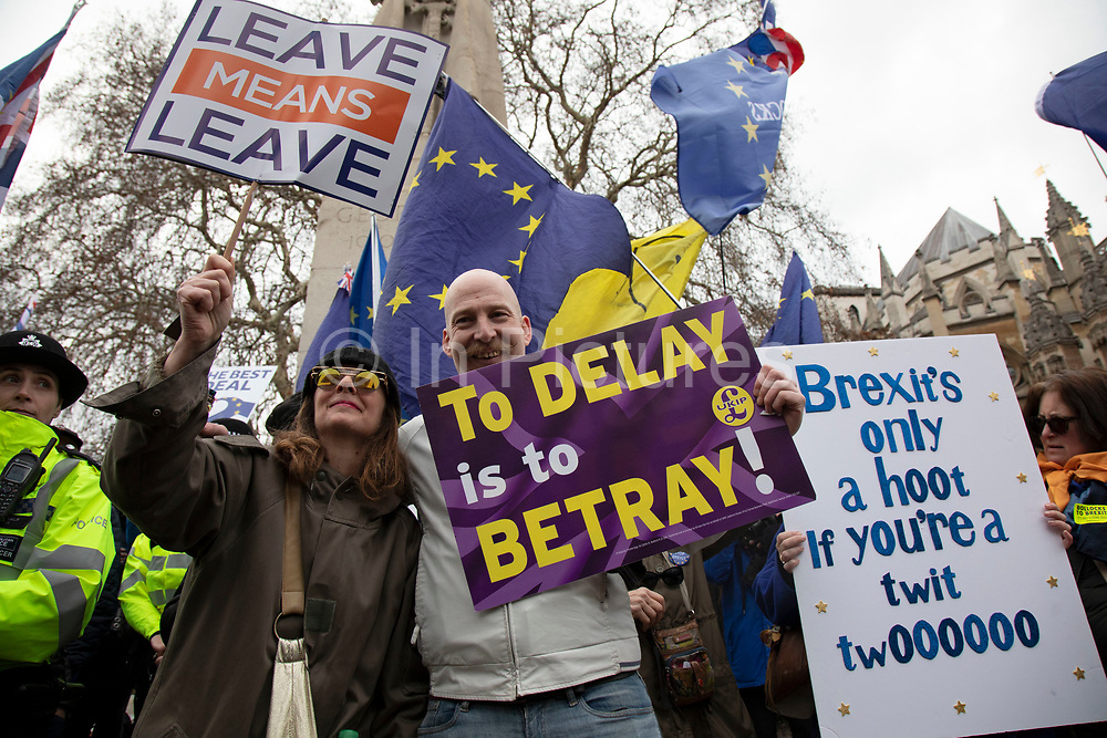 Leave means leave pro Brexit anti Europe demonstrator protests with a to delay is to betray placard in Westminster opposite Parliament on the day MPs vote on EU withdrawal deal amendments on 29th January 2019 in London, England, United Kingdom.