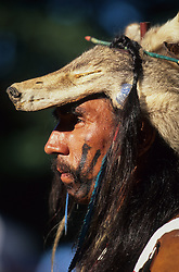North America, USA, Washington, Seattle. Native American dancer in wolf headdress at Seafair powwow