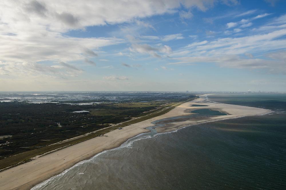 Nederland, Zuid-Holland, Gemeente Westland, 23-10-2013; Delflandse Kust ter hoogte van Ter Heijde en Monster, Hoek van Holland en Maasvlakte aan de horizon. Zandmotor, aanleg van kunstmatig schiereiland door het opspuiten van zand voor de kust. Wind, golven en stroming zullen het zand langs de kust verspreiden waardoor breder stranden en duinen ontstaan. De zandmotor is een experiment in het kader van kustonderhoud en kustverdediging. In de achtergrond de kassen van het Westland.<br /> Sand Engine, construction of artificial peninsula by the raising of sand for the coast of Ter Heijde (near the Hague). Wind, waves and currents will distribute the sand along the coast yielding wider beaches and dunes along the coastline. The Sand Engine is a experiment for coastal maintenance of coastal defense. In the background the Westland greenhouses.<br /> luchtfoto (toeslag op standard tarieven);<br /> aerial photo (additional fee required);<br /> copyright foto/photo Siebe Swart