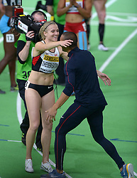 United States' Ashton Eaton (R,front) celebrates with his wife, Canada's Brianne Theisen Eaton after she won the women's 800-meter sprint of the pentathlon and the overall pentathlon event during day two of the IAAF World Indoor Championships at Oregon Convention Center in Portland, Oregon, the United States, on March 18, 2016. EXPA Pictures © 2016, PhotoCredit: EXPA/ Photoshot/ Yin Bogu<br /> <br /> *****ATTENTION - for AUT, SLO, CRO, SRB, BIH, MAZ, SUI only*****