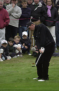 19/10/2003 - Photo  Peter Spurrier.2003 HSBC World Match Play Championship - Wentworth.Sunday - Final Day- Ernie Els v Thomas Bjorn:.Thomas Bjorn chip's onto the green with a very young gallery watching.......[Mandatory Credit Peter Spurrier/ Intersport Images]