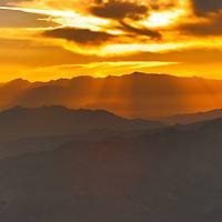 Layering of the mountains at sunset Death Valley California.