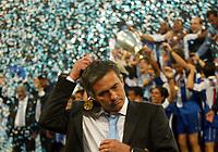 Fotball<br /> Photo: Scott Heavey, Digitalsport.<br /> FC Porto v AS Monaco. Champions League Final. 26/05/2004.<br /> Jose Mourinho leaves the party early as his Porto team lift the Champions League Cup