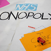A monopoly game laid out, selling off public services..The Health and Care Bill has been passed by Parliament and is due to go to the House of Lords. In protest against the bill which aim to deconstruct and privatise large parts of the NHS UK Uncut activists together with health workers and trade unionists blocked the Westminster Bridge from 1pm til 5.30pm.