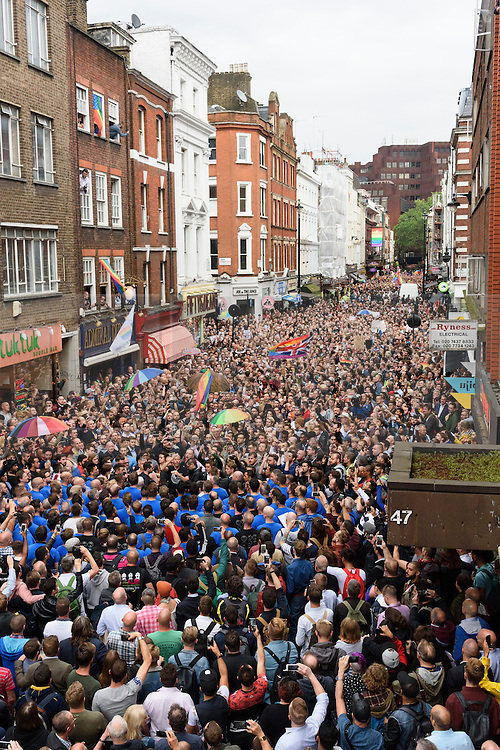 © Licensed to London News Pictures. 13/06/2016. Thousands of London's gay village honour victims of the Pulse shooting in the United States with a 2 minute silence.  It is alleged that The gunman, Omar Mateen killed at least 50 people in Pulse nightclub in Floriday, USA.  London, UK. Photo credit: Ray Tang/LNP