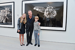 DAVID YARROW and his children JADE YARROW and CAMERON YARROW at a private view of photographs by wildlife photographer David Yarrow included in his book 'Encounter' held at The Saatchi Gallery, Duke of York's HQ, King's Road, London on 13th November 2013.