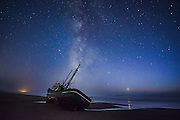 """Venus sets over the Pacific Ocean as the Milky Way illuminates the wreck of """"Verna A II,"""" a 54' commercial fishing vessel that ran ashore on Salmon Creek Beach near Bodega Bay, California in September, 2016."""