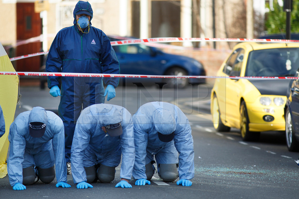 © licensed to London News Pictures. London, UK 01/03/2014. Police have launched a double murder investigation after two men, believed to be in their 20s, were found injured in a vehicle and later died in Leytonstone, east London on Saturday, 1 March 2014. Photo credit: Tolga Akmen/LNP