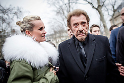 File photo : French singer Johnny Hallyday and his wife Laeticia during a national tribute to the victims of the January and November 2015 terror attacks, at Place de la Republique square in Paris, France on January 9, 2016. France's biggest rock star Johnny Hallyday has died from lung cancer, his wife says. He was 74. The singer - real name Jean-Philippe Smet - sold about 100 million records and starred in a number of films. Photo by Denis Allard/Pool/ABACAPRESS.COM