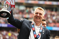 May 27, 2019 - London, England, United Kingdom - Aston Villa Manager Dean Smith holds the play off trophy following his sides win during the Sky Bet Championship Play Off Final between Aston Villa and Derby County at Wembley Stadium, London on Monday 27th May 2019. (Credit Image: © Mi News/NurPhoto via ZUMA Press)