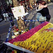 "A memorial has been placed where a young Spanish schoolboy boy called 'Diego' died at Seven Dials, Covent Garden, London, England, UK. If we drove past this place where someone's life ended, the victim would just be an anonymous statistic but flowers are left to die too and touching poems and dedications are written by family and loved-ones. One reads: """"Diego our friend, we are sorry you had to die like this."" ""School will never be the same without you."" From a project about makeshift shrines: ""Britons have long installed memorials in the landscape: Statues and monuments to war heroes, Princesses and the socially privileged. But nowadays we lay wreaths to those who die suddenly - ordinary folk killed as pedestrians, as drivers or by alcohol, all celebrated on our roadsides and in cities with simple, haunting roadside remberences."