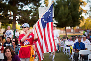 15 APRIL 2011 - PHOENIX, AZ: A Tea Party supporter with an American flag at the Arizona State Capitol in Phoenix, AZ, Friday. About 500 supporters of the Tea Party movement rallied Friday at the Arizona State Capitol to mark tax day. They protested high taxes, the federal deficit, the debt limit and immigration policy. About 50 pro-immigrant protesters held a counter rally at the capitol. At least one person was arrested, and others led away by police after several shouting matches between Tea Party supporters and the immigrants rights protesters broke out.     Photo by Jack Kurtz