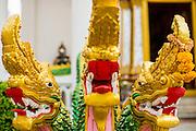 27 NOVEMBER 2012 - BANGKOK THAILAND: Naga heads guard the entrance of the ordination hall at Wat Sri Boonreung on Klong Saen Saeb in Bangkok, Thailand. Nagas are mythical serpents. In Theravada Buddhism practiced in Thailand, Cambodia and Laos, Nagas protect the temple.      PHOTO BY JACK KURTZ