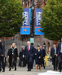 Prime Minister and party leader Boris Johnson and Home Secretary Priti Patel arrive to hear Chancellor of the Exchequer Sajid Javid deliver his keynote speech at the Conservative Party conference in Manchester.<br /> <br /> © Dave Johnston / EEm