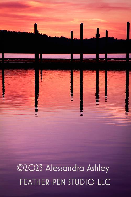 Last glimpse of setting sun's red and purple tones over lake at Coeur d'Alene, Idaho, USA.