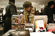 Shopping at the chic, fashionable & stylish 'Colette' shop, rue St.Honoré, in the centre of Paris. The shop has three floors; on the basement is the restaurant; on the ground floor, books, jewellery, cameras and mobile telephones, cd's and dvds, and a bazaar with a bit of everything; on the first floor is ladies and mens clothes.///Books for sale at Colette's
