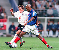 Nick Barmby (England) and Nicolas Anelka (France), France v England, Stade de France , 2/09/2000. Credit: Colorsport.