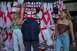 © Licensed to London News Pictures.  10/07/2021. London, UK. Two women walk past a souvenir shop in central London ahead of the EURO 2020 final in Wembley between England and Italy tomorrow evening (Sunday). Photo credit: Marcin Nowak/LNP