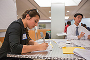 Purchase, NY – 31 October 2014. Jessica Tesoro, from Valhalla High School, taking notes.  The Business Skills Olympics was founded by the African American Men of Westchester, is sponsored and facilitated by Morgan Stanley, and is open to high school teams in Westchester County.