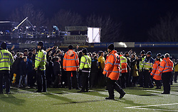 Sutton United fans on the pitch after the game