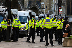 © Licensed to London News Pictures. 06/01/2021. London, UK. A huge Police presence after anti-lockdown protesters descended on Parliament Square in central London with some being arrested as Police get tough on breaking lockdown rules. Yesterday, Prime Minister Boris Johnson plunged England into another lockdown as he ordered schools to close and office workers to work from home in his televised address to the nation. This week, the first person in the world was vaccinated with the Oxford AstraZeneca Covid-19 vaccine with over 500,000 doses made available for high risk groups as the government race to vaccinate 13 million people in seven weeks. Photo credit: Alex Lentati/LNP