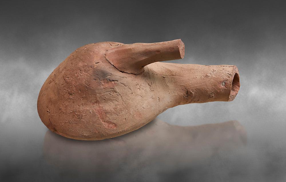 Hittite terracotta flask from the Hittite capital Hattusa, Hittite New Kingdom 1650-1450 BC, Bogazkale archaeological Museum, Turkey. Grey  background