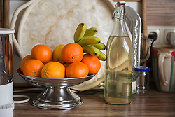 Fruit bowl with elderberry syrup on kitchen counter, Munich, Bavaria, Germany